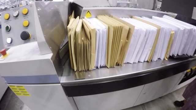 envelopes sit in crates as they move along a mail sorting machine conveyor inside a deutsche post ag postal sorting office in frankfurt germany on... - post structure stock videos & royalty-free footage