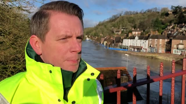 environment agency flood manager marc lidderth commenting on efforts to protect ironbridge in shropshire from further flooding. followed by footage... - ironbridge shropshire stock videos & royalty-free footage