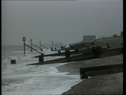 future map of britain; england, east anglia coast seq waves pounding onto coast - east anglia stock-videos und b-roll-filmmaterial
