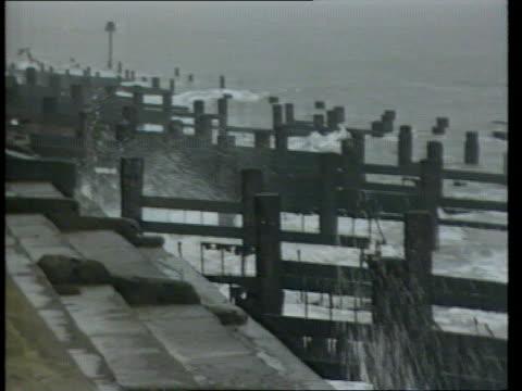 future map of britain; england, east anglia coast seq waves crashing on to beach - east anglia stock-videos und b-roll-filmmaterial