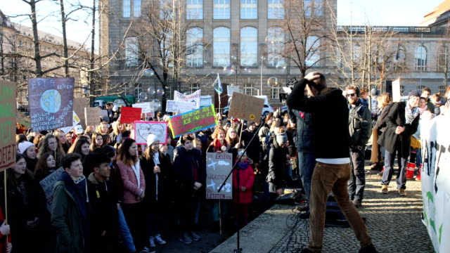 environmental activist dr tadzio müller during his speech to high school students striking high school students march to protest for more effective... - climate policy stock videos & royalty-free footage