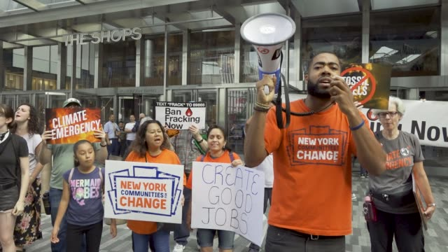 environmental activist rally outside the skyscraper building at 30 hudson yards in midtown manhattan during cnn's studios live coverage of the... - participant stock videos & royalty-free footage
