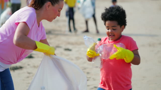 environmental beach cleanup - protection stock videos & royalty-free footage