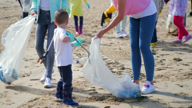 environmental beach cleanup - plastic stock videos & royalty-free footage