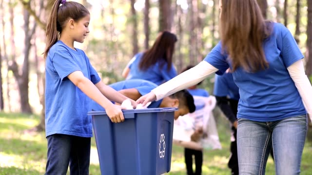 environmental clean up. volunteers pick up trash in local park. - environmental cleanup stock videos & royalty-free footage