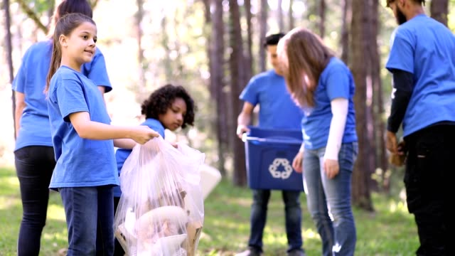 environmental clean up. volunteers pick up trash in local park. - healthcare worker stock videos & royalty-free footage