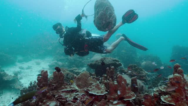 environmental cleanup volunteer scuba diver underwater removing nets - aqualung diving equipment stock videos & royalty-free footage