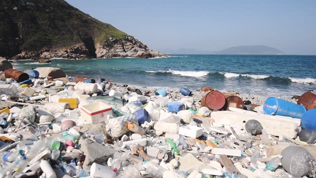 environmental destruction from plastic waste causes climate change, pollution and climate change, and destroys oceans - littering stock videos & royalty-free footage