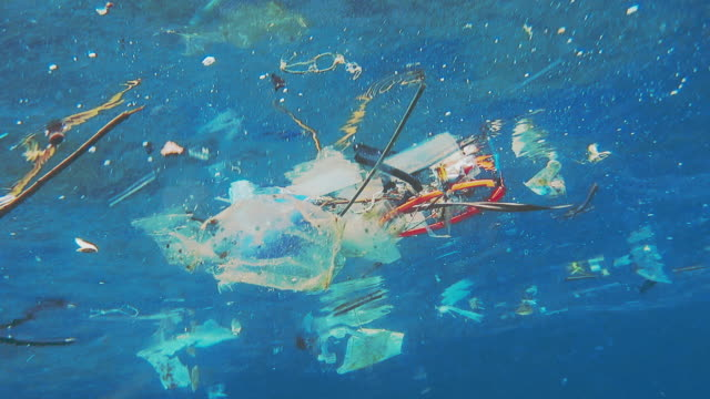 environmental issue underwater plastic in the ocean - plastic stock videos & royalty-free footage