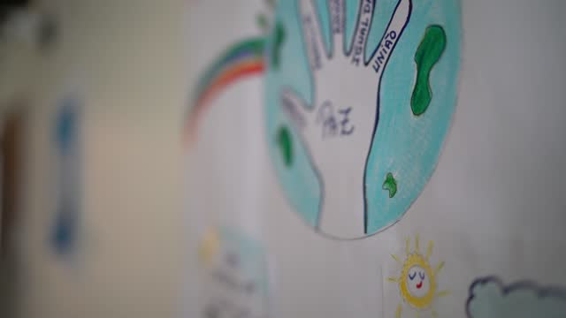 environmental issues / peace poster hanging on school's wall (in portuguese) - human role stock videos & royalty-free footage