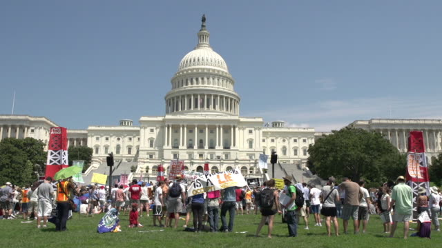 environmental protesters at antifracking rally at us capitol on july 28 2012 in washington dc - argillite video stock e b–roll