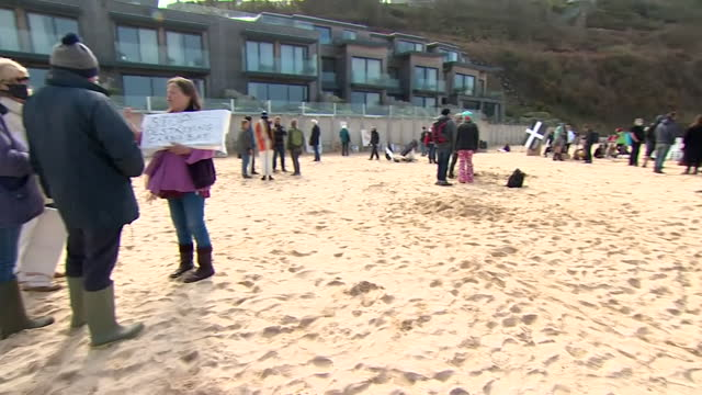 environmental protestors demonstrating on a cornwall beach before the g7 summit - environmental issues stock videos & royalty-free footage