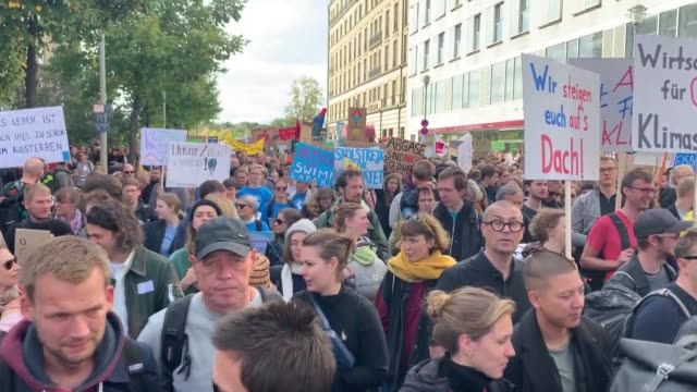 environmentalist gather during a demonstration to draw attention to global warming and climate change in berlin germany on september 20 2019 millions... - clima video stock e b–roll