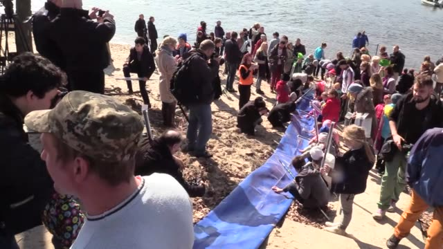 environmentalists and children release young fish of carps during an event to stock with fish the dnieper river organised by ukraine's environmental... - world water day stock videos and b-roll footage