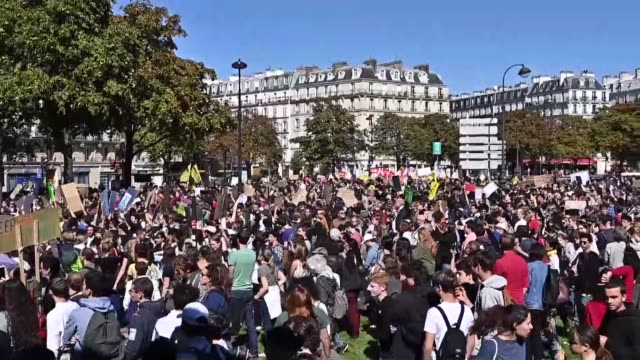 environmentalists gather during a demonstration to draw attention to global warming and climate change in paris france on september 20 2019 millions... - climate stock videos & royalty-free footage