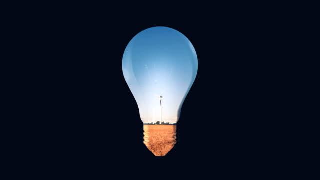 vidéos et rushes de ampoule électrique respectueuse de l'environnement - image composite numérique