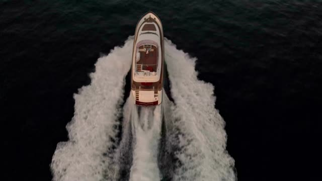 epic aerial view of a luxury yacht out on the sea - yacht stock videos & royalty-free footage