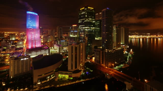 epic day to night time lapse of skyline miami downtown at night. miami tower illuminated as usa flag - aerial stock videos & royalty-free footage