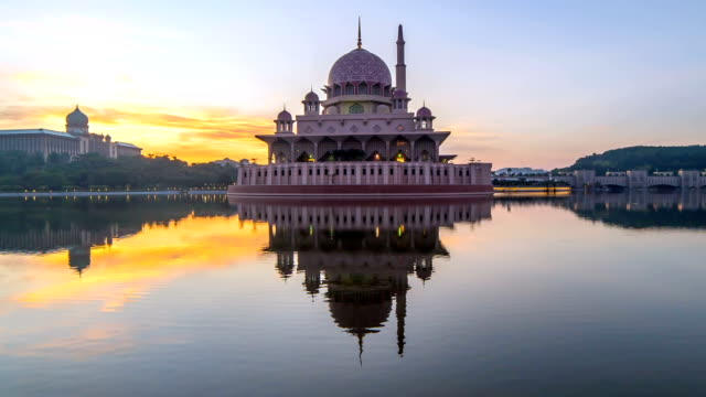 epic sunrise at putrajaya mosque. zoom out - putrajaya stock videos & royalty-free footage