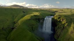 Epic view of Skogafoss waterfall in green Iceland landscape