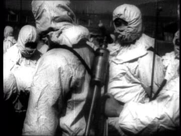vídeos de stock, filmes e b-roll de epidemic prevention workers search fields for contaminated insects dropped by american planes / close ups of insects / spraying insecticide over... - artigos de vidro de laboratório