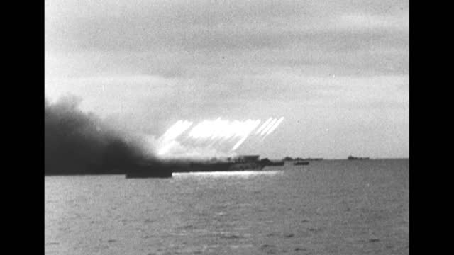 """episode i-03] greatest headlines of the century title sequence / title card: """"d-day landings at normandy"""" / [may 1944] german soldiers dig in sand to... - ship stock videos & royalty-free footage"""