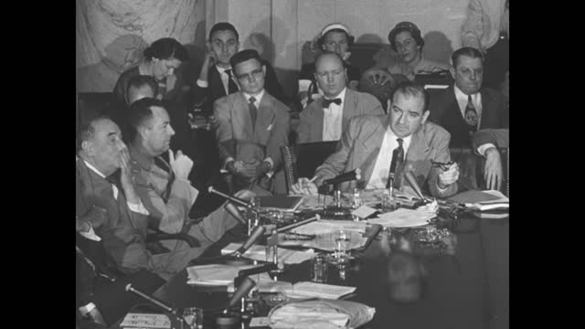 """episode i-06] greatest headlines of the century title sequence / title card: """"mccarthy at war with army"""" with photo of sen. joseph mccarthy / [feb... - court hearing stock videos & royalty-free footage"""
