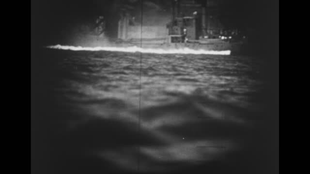 """episode m-08] greatest headlines of the century title sequence / title card: """"secret sub operations bared"""" / 1942: submarine moves in atlantic ocean... - underwater stock videos & royalty-free footage"""