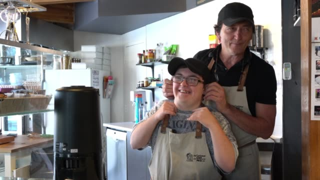 equal opportunity working down syndrome cafe small business - disability stock videos & royalty-free footage