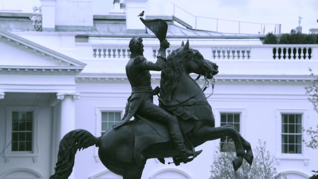 stockvideo's en b-roll-footage met la equestrian statue of andrew jackson, north portico of the white house beyond / washington, d.c., united states - letterbox format