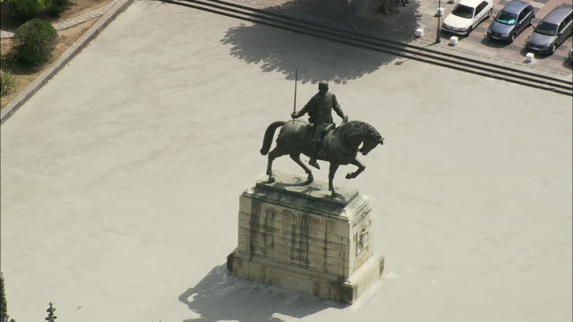 AERIAL WS Equestrian statue of King Nuno Alvares Pereira at Batalha monastery / Batalha, Leria, Portugal