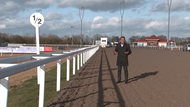 equine flu forces the cancellation of all british horse racing england cheltenham racecourse various of racehorse ridden along training track during... - cheltenham racecourse stock videos and b-roll footage