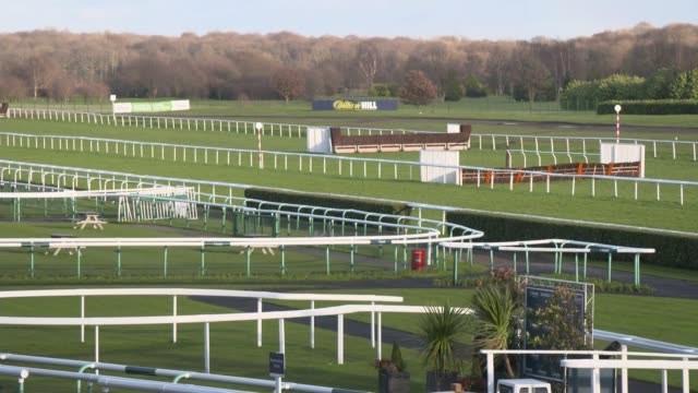 equine flu forces the cancellation of all british horse racing; england: south yorkshire: doncaster racecourse: ext gvs deserted racecourse and... - cheltenham stock videos & royalty-free footage