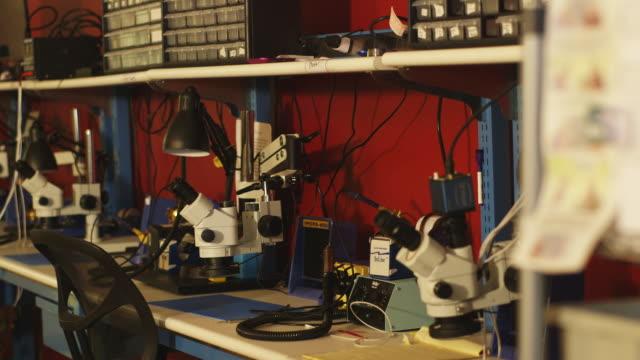 Equipment in laboratory, pan left