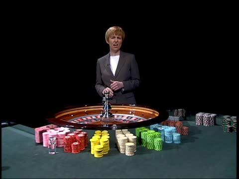 report blames company for financial problems; itv evening news: caroline kerr itn england: london: gir: int i/c next roulette table roulette wheel... - itv evening news stock videos & royalty-free footage