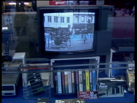 stockvideo's en b-roll-footage met equity strike; ulk 2.2.1981 ext tv in shop window int man looking at videos for sale in shop - channel 4 news