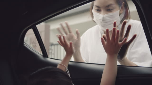 er and kiss her, however she is expressing positive emotion when playing with granny over the car window. - touching stock videos & royalty-free footage