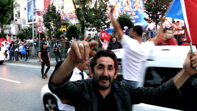 erdogan's supporters celebrate outside the ak party headquarters on june 24 2018 in istanbul turkey turkey's president recep tayyip erdogan's 16year... - president stock videos & royalty-free footage