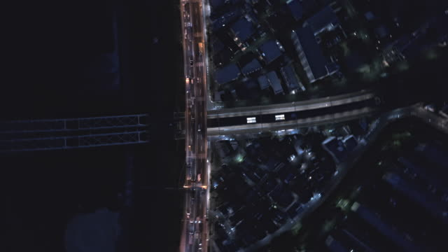 erial view of highway across the residential district - liyao xie stock videos & royalty-free footage