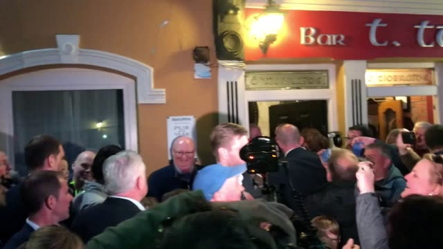 eric and donald trump junior visit a pub in doonbeg village co clare during their visit to ireland the pair are greeted by locals who turned to greet... - donald trump us president stock videos and b-roll footage