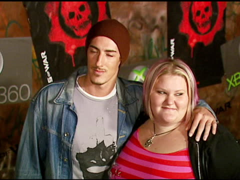 eric balfour and guest at the xbox 360 'gears of war' launch at hollywood forever cemetery in los angeles, california on october 25, 2006. - ギアーズオブウォー点の映像素材/bロール