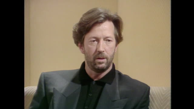 eric clapton talks about playing older songs live saying 'we try and keep it updated a little bit if we can' - psychedelische musik stock-videos und b-roll-filmmaterial