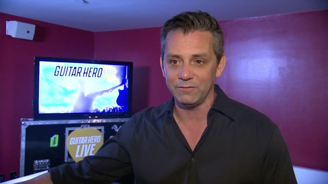 interview eric hirshberg on how much has changed since the last release says being a rock star is the most powerful fantasy in gaming on ghtv... - モダンロック点の映像素材/bロール