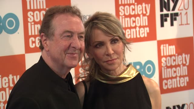eric idle and tania kosevich at the 49th annual new york film festival - 'george harrison: living in the material world' at new york ny. - エリック アイドル点の映像素材/bロール