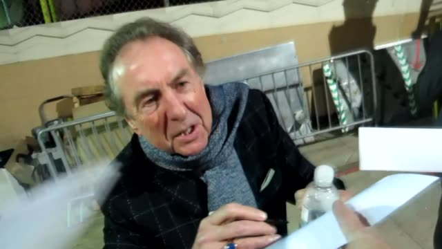 eric idle greets fans at the pantages theatre in hollywood 02/28/12 - エリック アイドル点の映像素材/bロール
