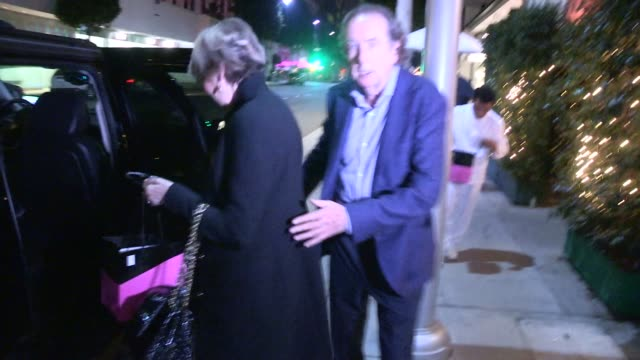 eric idle tania kosevich departing mr chow in beverly hills in celebrity sightings in los angeles - eric idle stock-videos und b-roll-filmmaterial