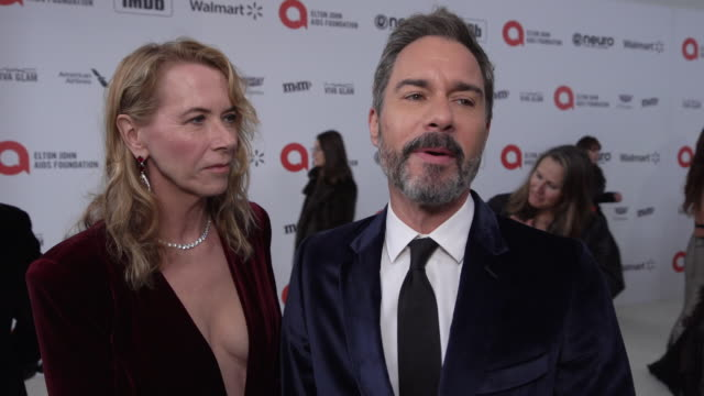 eric mccormack and janet holden at the 28th annual elton john aids foundation academy awards viewing party sponsored by imdb, walmart and neuro... - eric mccormack stock videos & royalty-free footage
