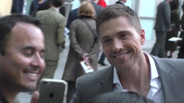 eric winter greets fans outside the traffik premiere at arclight cinemas in in hollywood in celebrity sightings in los angeles - celebrity sightings stock videos & royalty-free footage