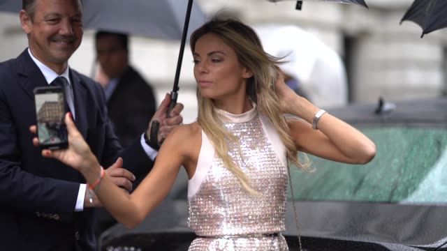 erica pelosini wears a sleeveless shiny glitter sequined dress with fringes pointy shoes a bag outside ralph russo during paris fashion week... - using phone stock videos & royalty-free footage