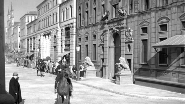 erich ludendorff walks away calmly as mounted police and nazis scatter or fall when weimar soldiers shoot to break up a nazi brownshirt parade. - nazism stock videos & royalty-free footage